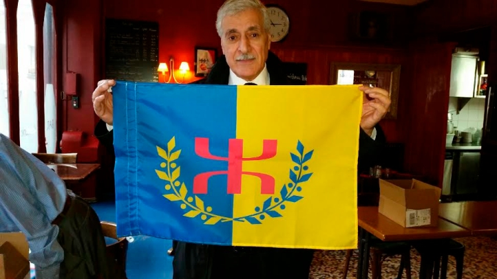 President Ferhat Mehenni, sporting the official flag of the Kabyle